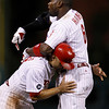 Philadelphia Phillies' Ryan Howard is restrained by Philadelphia Phillies Placido Polanco during the 14th inning of a baseball game against the Houston Astros in Philadelphia, Tuesday, Aug. 24, 2010. Houston won 4-2 in 16 innings. Howard was tossed by third base umpire Scott Barry (AP Photo/Matt Rourke)