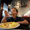 Seven-year-old Dominic Chiodo, of Des Moines, Iowa, eats eggs benedict at the Drake Diner, Tuesday, Aug. 24, 2010, in Des Moines, Iowa. The egg recall hasn't affected this popular breakfast spot in downtown Des Moines. Manager Shannon Vilmain credits quality suppliers for keeping the diner stocked with safe eggs. She said that while more customers have been asking about the brand names of the eggs used and whether they're safe, she hasn't noticed a decline in the number of orders that use eggs. (AP Photo/Charlie Neibergall)