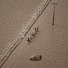 Pakistani residents walks in flood waters near Thul, in Sindh province, southern Pakistan, Tuesday, Aug. 24, 2010. (AP Photo/Kevin Frayer)