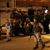 Lebanese soldiers patrol the area after clashes erupted between supporters of the Shiite Hezbollah and a Sunni conservative group in the mixed residential area of Bourj Abu Haidar near central Beirut, Lebanon, Tuesday, Aug. 24, 2010. Lebanese Shiite and Sunni groups traded machine gun fire and grenades in Beirut on Tuesday, killing two people and wounding several others just blocks from a busy downtown packed with tourists at this time of year. (AP Photo/Hussein Malla)