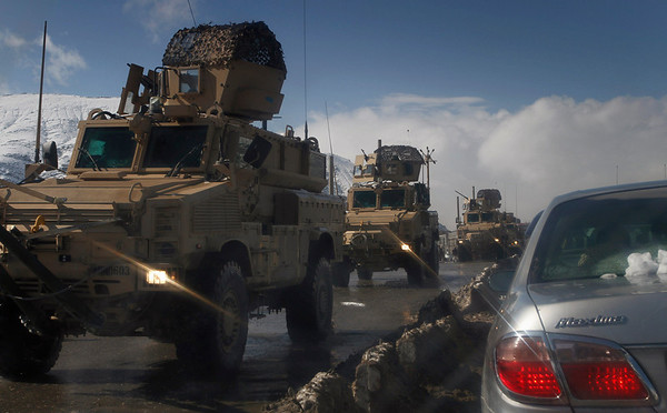 A military convoy of U.S. soldiers are seen driving along a road in Kabul, Afghanistan, on Monday, Feb. 8, 2010. (AP Photo/Musadeq Sadeq)