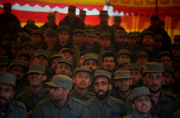 Newly graduated Afghan police officers watch a graduation ceremony at a police academy in Kabul, Afghanistan, Wednesday, Feb. 3, 2010. (AP Photo/Altaf Qadri)
