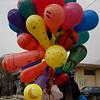An Afghan boy carries balloons for sale in Kabul, Afghanistan on Sunday, Feb. 21, 2010. (AP Photo/Rahmat Gul)
