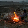 An Afghan street boy makes a fire to warm up his hands on a garbage pile in Kabul, Afghanistan Saturday, Feb. 20, 2010. (AP Photo/Rahmat Gul)