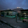 An Afghan man offers evening prayers outside a closed shop in Kabul, Afghanistan, Thursday, Feb. 4, 2010, (AP Photo/Altaf Qadri)