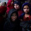 Pakistani girls are seen waiting to get a ration of rice during a donated food distribution in Islamabad, Pakistan, Monday, Feb. 8, 2010. (AP Photo/Muhammed Muheisen)