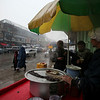 Afghans drink hot soup at a roadside vendor as it snows in Kabul, Afghanistan, Friday, Feb. 5, 2010 (AP Photo/Altaf Qadri)