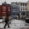 Through thickly falling snow, a UPS delivery man brings a package to a row house in the Capitol Hill neighborhood of Washington,  Friday, Feb. 5, 2010.  (AP Photo/Jacquelyn Martin)