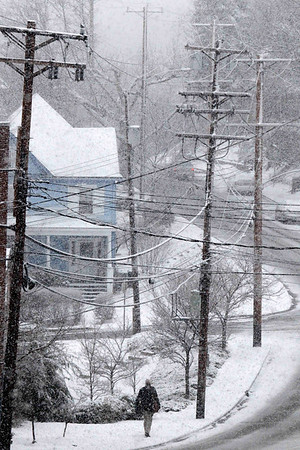 Snow begins to fall in Mt. Lebanon, Pa., before evening rush hour Friday, Feb. 5, 2010. (AP Photo/Gene J. Puskar)