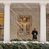A Marine stands sentry as the snow falls while President Barack Obama works in the West Wing of the White House in Washington, Friday, Feb. 5, 2010. Shoppers jammed aisles and emptied stores of milk, bread and shovels Friday as a massive snowstorm blew into the Mid-Atlantic with forecasters predicting a record 30 inches or more for the nation's capital. (AP Photo/Charles Dharapak)