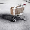 An abandoned grocery cart sits in a snow covered parking lot on the south side of Indianapolis, Friday, Feb. 5, 2010. A winter storm warner is in effect in Central Indiana until Saturday morning.  (AP Photo/Michael Conroy)