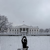 A photographer takes a picture of the North Grounds of the White House in Washington, Wednesday, Feb. 3, 2010, following snowfall in Washington area. (AP Photo/Pablo Martinez Monsivais)