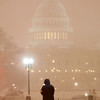 With the Capitol in the background, a lone pedestrian walks in the snow along the National Mall in Washington, Friday, Feb. 5, 2010. (AP Photo/Charles Dharapak)