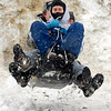 Daniel Watkins, Caroline Haynes and Jason Ruth fly over a bump as they sled at Craighead Forest Park in Jonesboro, Ark., Monday, Feb. 8, 2010. (AP Photo/The Jonesboro Sun, James Byard)