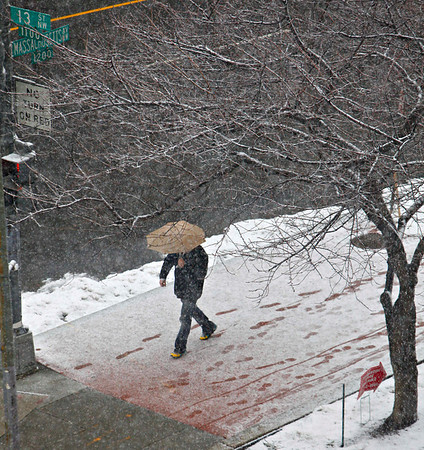A pedestrian walk in the snow in Washington, Friday, Feb. 5, 2010, as a large winter storm approaches the nation's capital.  (AP Photo/J. Scott Applewhite)