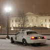 A Uniformed Division Secret Service officer stands watch on Pennsylvania Avenue in front of the White House in Washington, Friday, Feb. 5, 2010, as snow falls in the Washington area.  (AP Photo/Charles Dharapak)