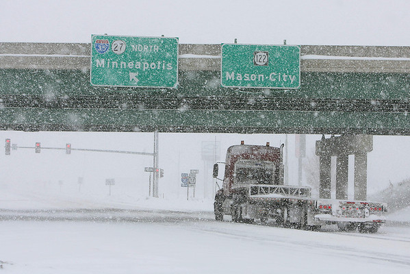 A semitrailer drives under an I-35 overpass Monday, Feb. 8, 2010 in Clear Lake, Iowa, as heavy snow from a new winter storm falls across an already snow-weary region. (AP photo/The Globe Gazette, Bryon Houlgrave)