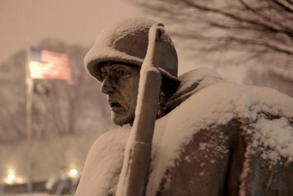 Snow covers the Korean War Veterans Memorial in Washington, Friday, Feb. 5, 2010. (AP Photo/Charles Dharapak)