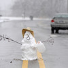 A snowman sits in the middle of a road Monday, Feb. 8, 2010, in Mountain Home, Ark. Snow fell over northern Ark., Monday, with some area receiving nearly 10 inches. (AP Photo/The Baxter Bulletin, Kevin Pieper)