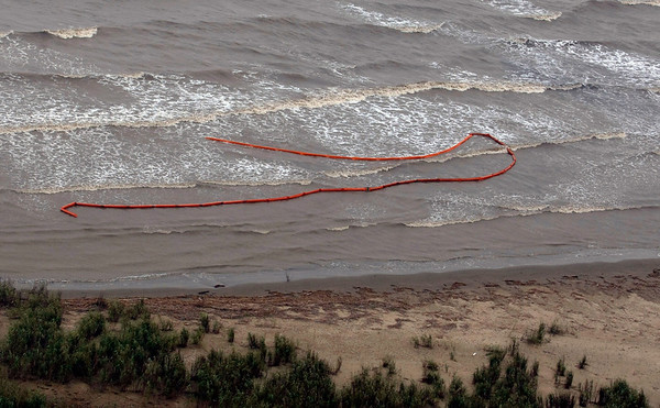 Oil booms that were placed in preparation of the looming oil spill from last week's collapse and spill of the Deepwater Horizon oil rig are seen strewn along the shoreline at Pass a Loutre, La., where the Mississippi River meets the Gulf of Mexico Friday, April 30, 2010. Wildlife in the region is vulnerable to the looming oil spill from last week's collapse and spill of the Deepwater Horizon oil rig. (AP Photo/Gerald Herbert)