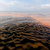 Oil makes a pattern in the waters of Chandeleur Sound La., Thursday, May 6, 2010. Oil giant BP PLC's oil rig exploded April 20, in the Gulf of Mexico killing 11 workers. It sank two days later, and oil is still pouring into the Gulf. (AP Photo/Alex Brandon)