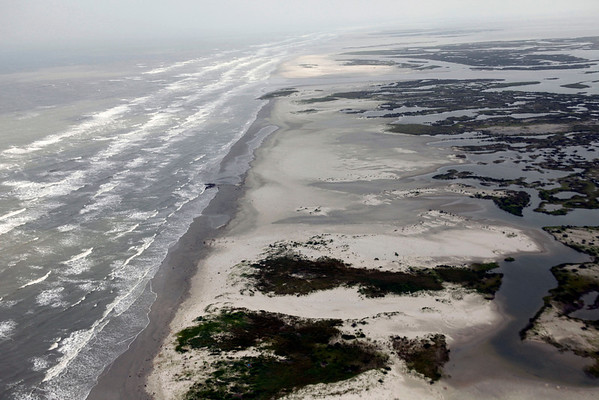 Unprotected stretches of the Chandeleur Islands, home of the Breton National Wildlife Refuge, are seen off the coast of Louisiana, Friday, April 30, 2010. Wildlife in the region are vulnerable to the looming oil spill from last week's collapse and spill of the Deepwater Horizon oil rig.(AP Photo/Gerald Herbert)