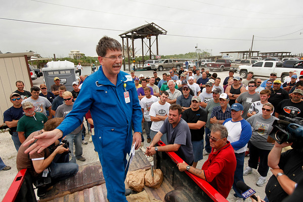 Peter Nowobilski, strategy project manager for British Petroleum, instructs out of work fishermen hoping to sign up to lay oil booms in Shell Beach, La., Saturday, May 1, 2010.  (AP Photo/Gerald Herbert)