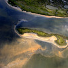 An aerial view of the northern Chandeleur barrier islands shows sheens of oil reaching land, Thursday, May 6, 2010 in the Gulf of Mexico. The islands rest 20 miles from the main Louisiana coastline.   (AP Photo/David Quinn)