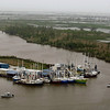 Shrimp boats are seen parked in Venice, La., near the mouth of the Mississippi River and the Gulf of Mexico, Friday, April 30, 2010. The Louisiana seafood industry is vulnerable to the looming oil spill from last week's collapse and spill of the Deepwater Horizon oil rig. (AP Photo/Gerald Herbert)