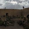 U.S. Marines rest in a compound as they push to the south of Marjah in Afghanistan's Helmand province on Sunday Feb. 21, 2010. (AP Photo/David Guttenfelder)