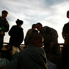 U.S. soldiers of the 1st Battalion, 17th Infantry Regiment, 5th Brigade, 2nd Infantry Division, buy goods from an Afghan street vendor passing with his trailer by an U.S. Army outpost in the Badula Qulp area, West of Lashkar Gah in Helmand province, southern Afghanistan, Monday, Feb. 22, 2010. (AP Photo/Pier Paolo Cito)