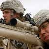 U.S. Sgt. U.S. Ryan Mack, 25, from Defiance, Ohio, spotter at left, talks at the radio as Spc. Thomas Leuthold, 20, from Hills, Minn., sniper, takes aim, as they  face Taliban insurgents during a firefight in the Badula Qulp area, West of Lashkar Gah in Helmand province, southern Afghanistan, Sunday, Feb. 21, 2010. (AP Photo/Pier Paolo Cito)