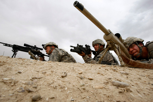 From left, U.S. Army Sgt. Erik Grafford, 22, from Missoula, Mont., sniper, Sgt. U.S. Ryan Mack, 25, from Defiance, Ohio, spotter and Spc. Thomas Leuthold, 20, from Hills, Minn., aim their guns toward Taliban insurgents during a firefight in the Badula Qulp area, West of Lashkar Gah in Helmand province, southern Afghanistan, Sunday, Feb. 21, 2010. (AP Photo/Pier Paolo Cito)