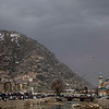 Clouds loom large as Afghan people shop at a market in Kabul, Afghanistan, Monday, Feb. 22, 2010. (AP Photo/Altaf Qadri)