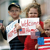 In this photo taken on March 9, 2010 photo, Blake Cochran, left, 7, Brooke Cochran, center, 6, and Bailee Cochran, 3, welcome home Georgia's National Guard Company A 108th Cavalry to Rome, Ga.  from Afghanistan. (AP Photo/The News Tribune, Ryan Smith) MANDATORY CREDIT