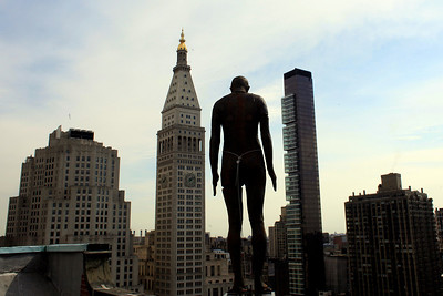 "A sculpture by Antony Gormley is on display on the roof of 1133 Broadway in the Nomad neighborhood of Manhattan, Wednesday, March 10, 2010, in New York. The sculpture, part of the installation ""Event Horizon,"" will be on view through Aug. 15. (AP Photo/Mary Altaffer)"