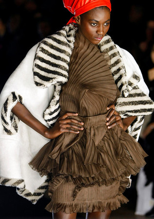 A model wears a creation by Japanese fashion designer Junko Shimada as part of her Fall-Winter 2010-2011 ready-to-wear fashion collection presented at The Grand Palais in Paris, Tuesday, March 9, 2010. (AP Photo/Francois Mori)