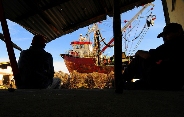 Fishermen rest in shade in Talcahuano, Chile, Wednesday, March 10, 2010. An 8.8-magnitude earthquake struck central Chile on Feb. 27, causing widespread damage. (AP Photo/Francisco Negroni)