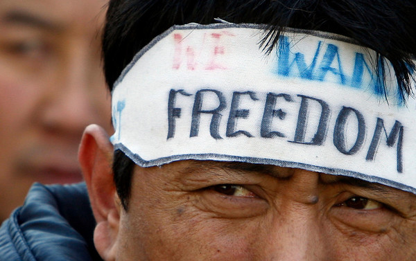 A man wears a headband during a demonstration to mark World Solidarity Day with Tibet in Brussels, Wednesday March 10, 2010. (AP Photo/Virginia Mayo)