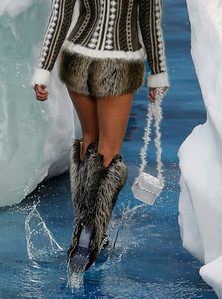 A model wears creations by German fashion designer Karl Lagerfeld for Chanel as part of his Fall-Winter 2010-2011 ready-to-wear fashion collection presented at The Grand Palais in Paris, Tuesday, March 9, 2010. (AP Photo/Francois Mori)
