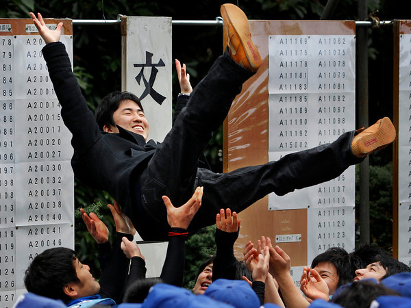 A student who successfully passed the entrance examination for the University of Tokyo gets a congratulatory toss as the results of Japan's most prestigious university exam is announced at its campus in Tokyo, Japan, Wednesday, March 10, 2010. (AP Photo/Itsuo Inouye)