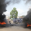 Togo riot police chase after supporters of opposition leader Jean-Pierre Fabre as they protested in Lome, Togo. Tuesday March 9, 2010. Riot police blocked the top opposition leader from reaching a demonstration he wanted to lead Tuesday, the fourth day of rising tension since the son of the country's former dictator was declared winner of a disputed presidential ballot.  (AP Photo/Sunday Alamba)