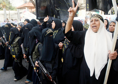 Palestinian women supporters of the Islamic Jihad movement march during a rally against Israel's decision to include two West Bank shrines on a list of national heritage sites, in the Jebaliya refugee camp, north of Gaza City, Wednesday, March 10, 2010. (AP Photo/Khalil Hamra)