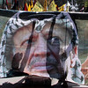 Palestinian protesters are seen silhouetted in a banner picturing late Palestinian leader Yasser Arafat during a march held at the Palestinian refugee camp of Yarmouk, near Damascus, Syria, Wednesday, March 17, 2010, against Israel's attempts to increase its influence and the rededication Monday of a historic synagogue in the Jewish quarter of the Old City. (AP Photo/Ola Rifai)