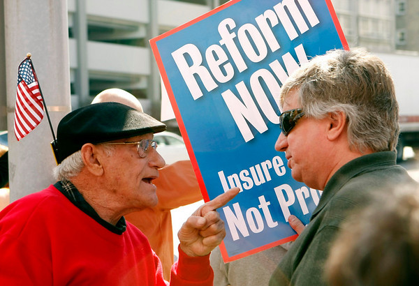 George Martin, left, and Walt Stoelting argue over health care reform during a rally outside the district office of Rep. Joe Donnelly, D-Granger,  in downtown South Bend, Ind., Thursday, March 18, 2010. Groups on both sides of the debate on the federal health care overhaul are keeping up the pressure on three Indiana Democratic congressmen who say they haven't decided how they'll vote. (AP Photo/South Bend Tribune, Marcus Marter)