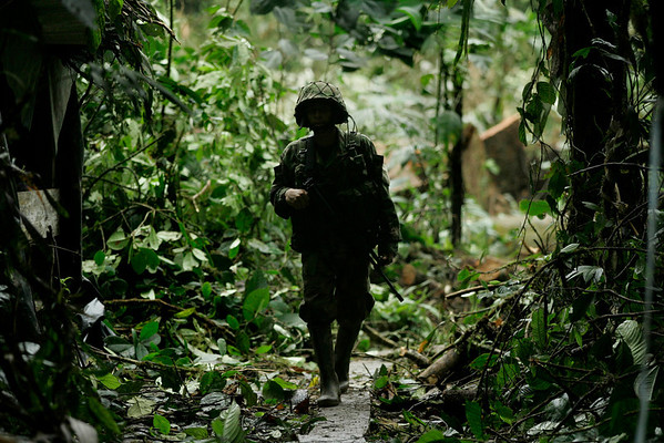 A soldier walks through a clandestine laboratory to produce cocaine  in Quebrada Guainia, in Colombia's southern Pacific coast, Wednesday, March 17, 2010. Troops seized cocaine and chemicals to produce the alkaloid at the lab that, according to the Army, belonged to rebels of the Revolutionary Armed Forces of Colombia, FARC.  (AP Photo/Christian Escobar Mora)