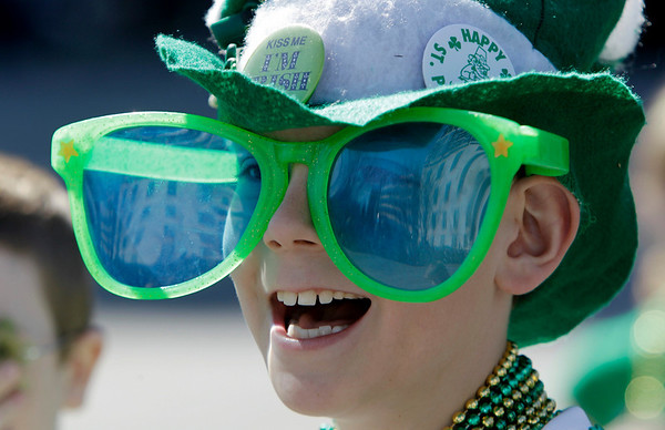 William Eckrich waits for candy and beads during the annual St. Patrick's Day parade in Indianapolis, Wednesday, March 17, 2010.  (AP Photo/Darron Cummings)