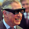 Britain's Prince of Wales wears a pair of 3D glasses as he looks at a 3D book, during a tour at a climate change seminar in  Budapest, Hungary, Thursday, March 18, 2010. (AP Photo / John Stillwell, pa)