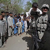 Specialist Derek Millard of Syracuse, N.Y. and the 1st Platoon 554th Military Police Company, plays with village children while taking a break from a patrol in the Koz Kunar district Thursday, March 18, 2010, in Nangarhar province Afghanistan. (AP Photo/Julie Jacobson)
