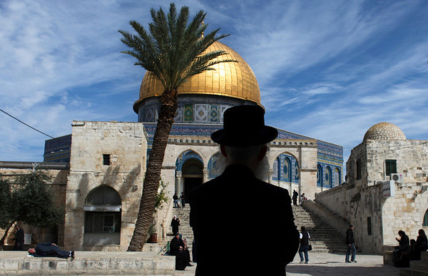 An ultra-Orthodox Jewish man stands in the Al Aqsa Mosque compound, also known to Jews as the Temple Mount, in Jerusalem's old city, Wednesday, March 17, 2010. Israel on Wednesday lifted its tight restrictions on Palestinian access to Jerusalem's holiest shrine and called off an extended West Bank closure after days of clashes between Palestinians and Israeli security forces. Despite moving to end the lockdown, Israel still kept thousands of police officers on alert as an uneasy calm settled over the holy city. (AP Photo/Tara Todras-Whitehill)